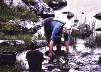 Washing dyed fleeces in the stream